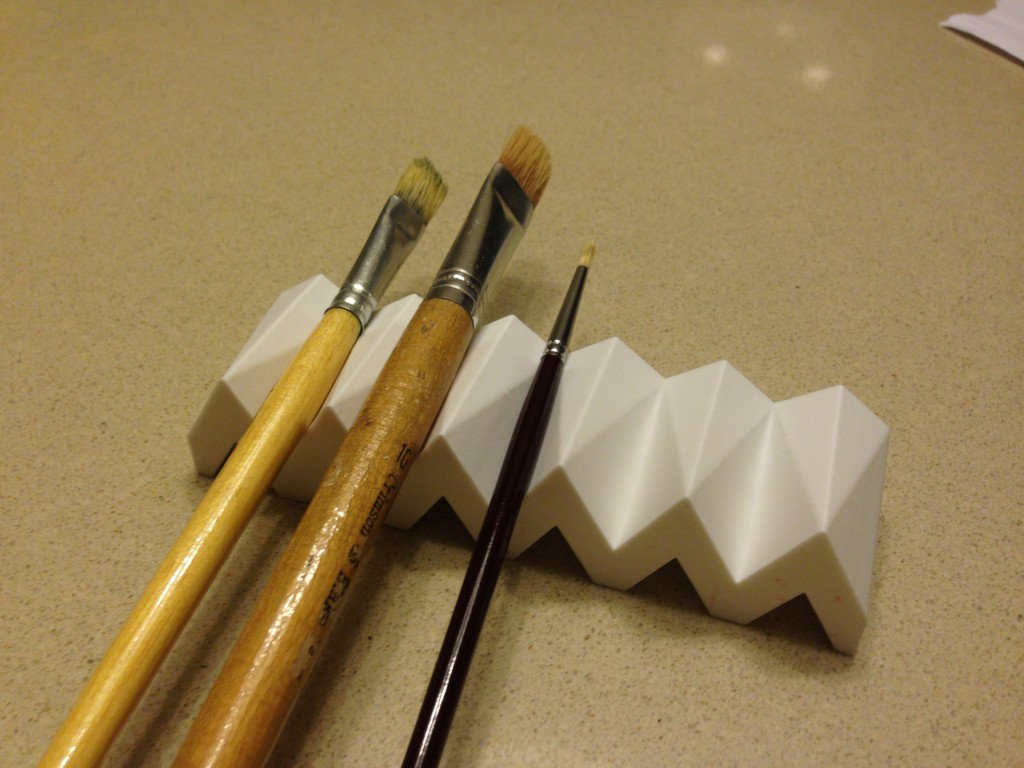 Printed holder with paintbrushes